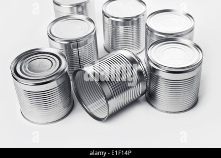 Tin cans. Cans are used for packing all sorts of goods - conserved food, chemical products such as paint, etc - Stock Photo