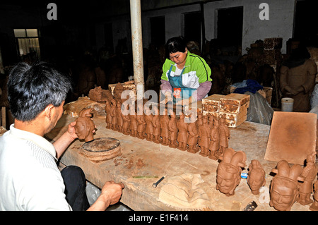 Terracotta Warrior souvenirs being made in factory by artist Xi'an China - Stock Photo