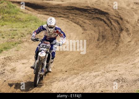 Motocross racer on dirt  track - Stock Photo