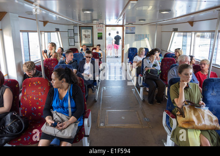 Brisbane Australia Queensland Brisbane River Brisbane Ferries ferry service CityCat boat passengers man woman cabin - Stock Photo