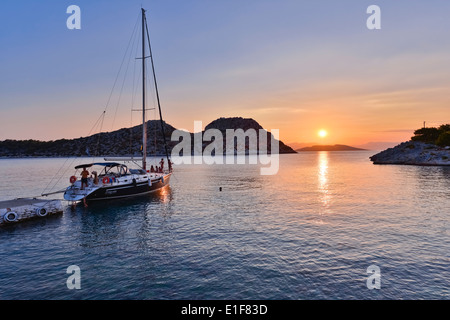 Magnificent sunset at Aponissos cove, on Agistri island in Saronic Gulf, one hour voyage from Piraeus, the main - Stock Photo