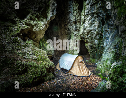 Tent in cave, extreme camping for climbers.