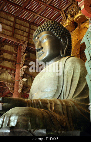 The world's largest bronze statue of the Buddha Vairocana housed in Todai-ji temple in Nara Japan - Stock Photo