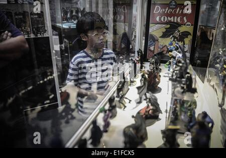 Kuala Lumpur, Malaysia. 2nd June, 2014. A boy look at Batman toys displayed during exhibition in conjunction with - Stock Photo