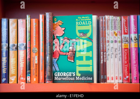 Roald Dahl book names 'George's Marvellous Medicine' on shelf of a library. - Stock Photo
