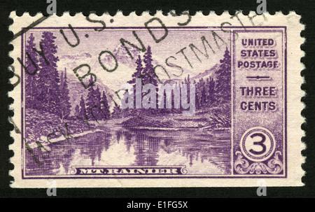 USA - CIRCA 1934: A stamp printed in United States of America shows Mount Rainier and Mirror Lake (Washington), - Stock Photo