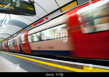 A train passing through a station on the London Underground, England UK - Stock Photo