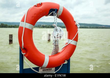 lifebuoy on the pier - Stock Photo