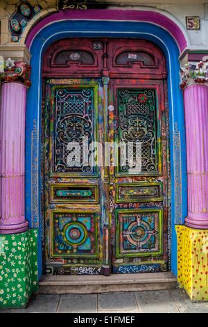 Paris, France. A colorful door on a Parisian street. - Stock Photo