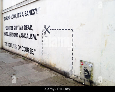 Whymark Avenue, London UK, June 3rd 2014. A piece of street art which namechecks Banksy has appeared on the wall - Stock Photo