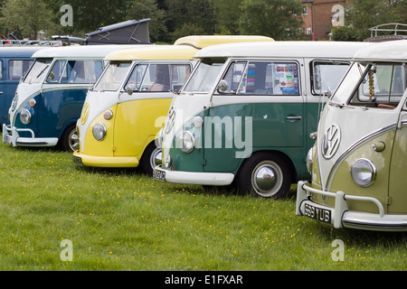 Line of VW Split Screen Volkswagen camper vans at a VW show - Stock Photo
