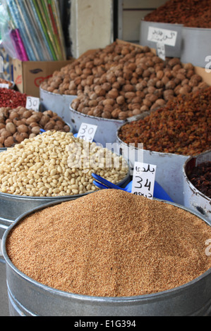 Dried fruits and legumes at a market stall in Morocco - Stock Photo