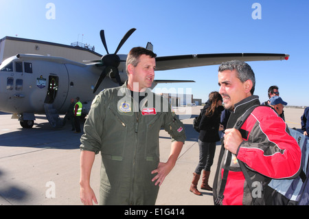 U.S. Air Force Lt. Col. Mike Depree, left, of the 119th Operations Group, welcomes Massimo Trocino to Hector International - Stock Photo