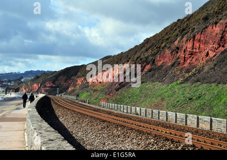 A cliff section of Old Red Sandstone near, Dawlish, South Devon - showing Devonian stratigraphy and the railway - Stock Photo