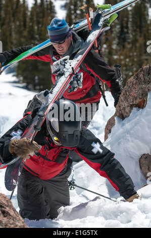 Two male ski patrollers working at the Crested Butte Ski Resort, Crested Butte, Colorado. - Stock Photo