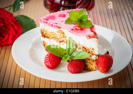Honey cake with strawberries decorated with mint - Stock Photo