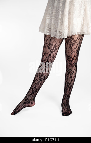 Legs in nice tights on white background. - Stock Photo
