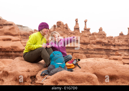 Mother and daughter hiking in Goblin Valley State Park near Hanksville, Utah. - Stock Photo