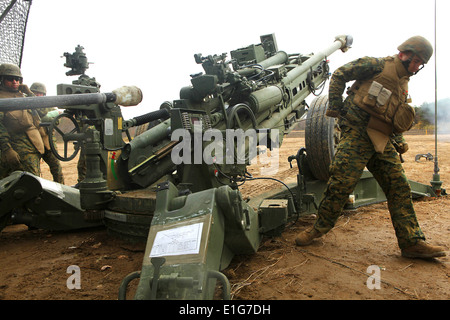 U.S. Marines fire a round from an M777A2 Lightweight 155 mm howitzer during Artillery Relocation Training Exercise - Stock Photo
