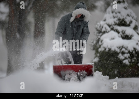 U.S. Airman 1st Class air traffic controller Peter Logar with 366th Operations Support Squadron removes snow from - Stock Photo