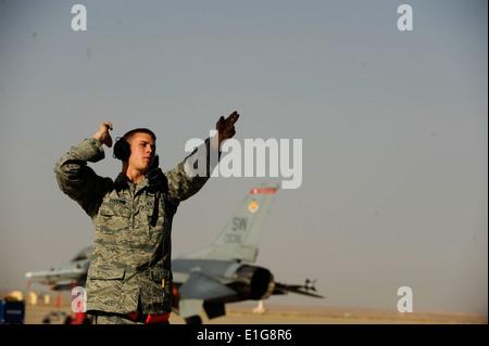U.S. Air Force Airman 1st Class Zach Goodwin marshals an aircraft during Falcon Air Meet 2010 at Azraq Air Base, - Stock Photo