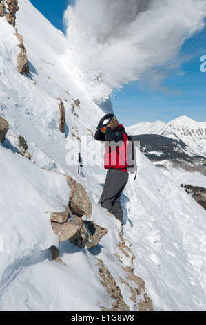 Male ski patroller doing avalanche control work at the Crested Butte Ski Resort, Crested Butte, Colorado. - Stock Photo