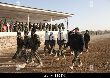 Afghan National Army soldiers march in formation during a pass in review at Forward Operating Base Hero in the Kandahar - Stock Photo
