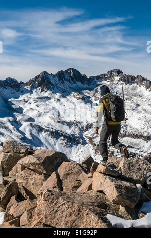 A man hiking along rocky ridge in the La Plata Mountains, Mayday, Colorado. - Stock Photo