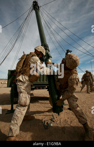 U.S. Marines with Headquarters and Service company, 3rd Battalion, 4th Marine Regiment, (3/4) set up an antenna - Stock Photo