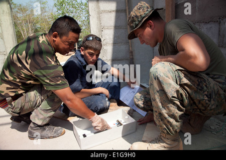 Malaysian army Sapper Cpl. Elegtrik Musslim, left, a combat engineer with the Royal Engineers Regiment, shows U.S. - Stock Photo