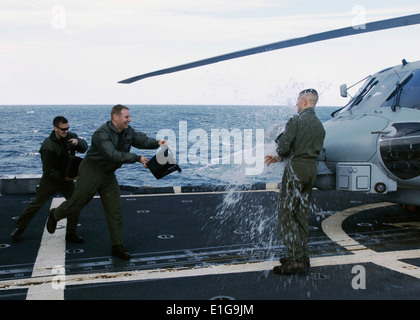 U.S. Navy Lt. Thomas J. Eisenstatt, with Helicopter Maritime Strike Squadron (HSM) 70 attached to the guided missile - Stock Photo