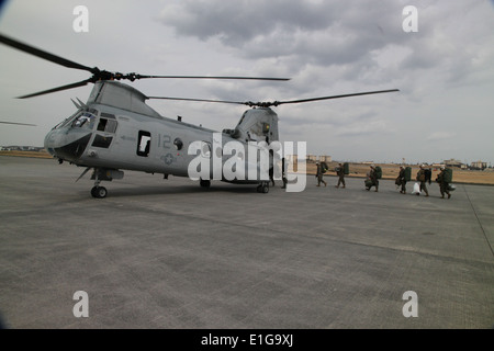 U.S. Marines and Sailors with III Marine Expeditionary Force (Forward) board a CH-46 Sea Knight Helicopter from - Stock Photo