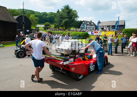 Red sports car in the paddock at Shelsley Walsh motor racing hill climb Worcestershire England UK - Stock Photo