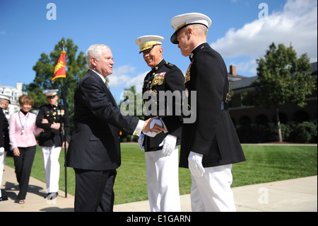 Secretary of Defense Robert M. Gates, left, shakes hands with the newly-appointed commandant of the U.S. Marine - Stock Photo