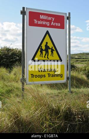 Military training area warning signs on Braunton Burrows near Saunton on the North Devon coast. - Stock Photo