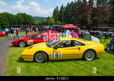 Ferrari sports cars in the paddock at Shelsley Walsh hill climb, Worcestershire England UK - Stock Photo
