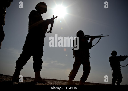 Afghan National Army (ANA) soldiers rehearse sighting in on their targets from the standing position while learning - Stock Photo
