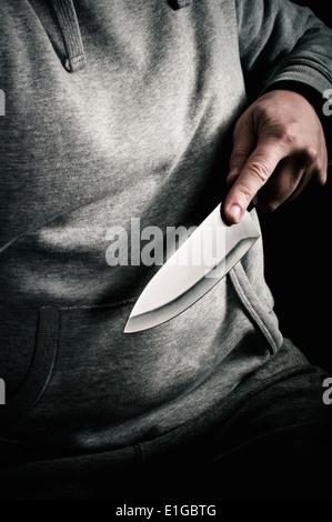 Knife point robbery - Stock Photo