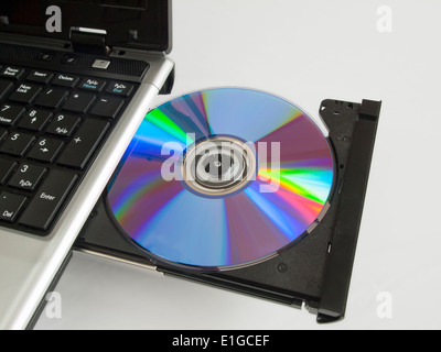 A rewritable CD ROM in the CD drive of a labtop computer. - Stock Photo