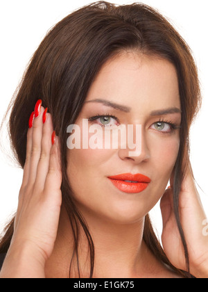 Pretty girl with red lipstick, ears covered with hands, three wise monkeys series. - Stock Photo