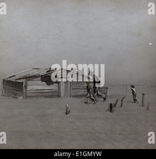 Photograph of a farmer and son walking in the face of a dust storm in Cimarron County, Oklahoma. Photograph taken - Stock Photo