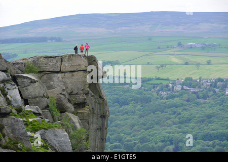Abseiling down the Cow and Calf rock face on Ilkley Moor, West Yorkshire, England, UK - Stock Photo