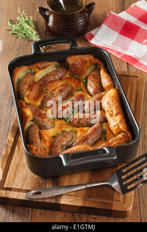 Toad in the hole. Sausages cooked in batter. UK Food - Stock Photo