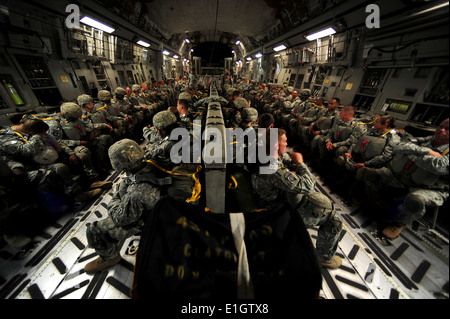 U.S. Soldiers assigned to the 82nd Brigade Support Battalion, 3rd Brigade, 82nd Airborne Division travel aboard - Stock Photo