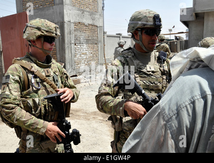U.S. Army 1st Lt. Alec Augustine-Marceil, left, a civil affairs officer with the Kandahar Provincial Reconstruction - Stock Photo