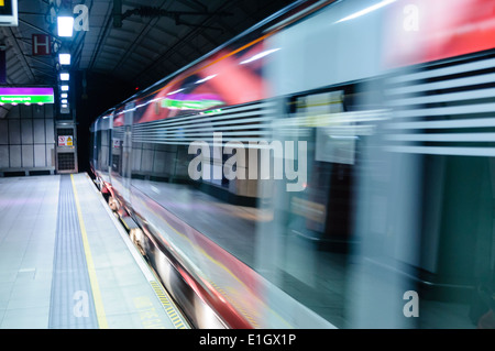 Heathrow Express train arrives at the platform at Heathrow Airport - Stock Photo