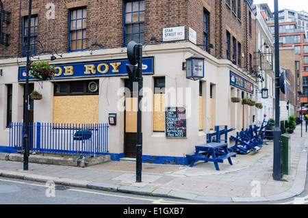 Rob Roy, a closed down and boarded up pub in Central London which has gone out of business - Stock Photo