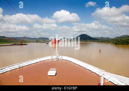 Cruise ship transits across Gatun lake on a beautiful day with cargo ships & Pedro Miguel lock ahead, Panama Canal, - Stock Photo