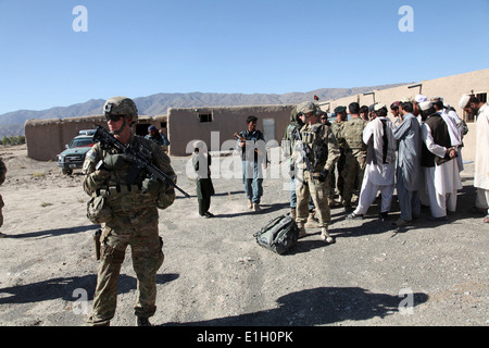 U.S. Soldiers with Alpha Company, 1st Battalion, 279th Infantry Regiment, Task Force Duke speak with Afghan village - Stock Photo