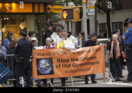 Demonstrators against the approval of the Keystone XL Pipeline on Madison Ave. in NYC waiting for President Obama - Stock Photo